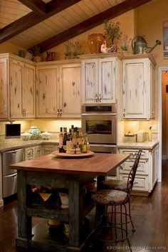 a more finished, less rustic look?  I like the countertops.  Kitchen of the Day: French Country Kitchen Island and Decor