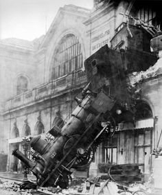 the old Gare Montparnasse, Paris, on October 23, 1895. It crossed 30 meters of the concourse before crashing through the window. Only one person was killed, amazingly enough... un pauvre in the shop below the window.