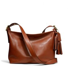 The Legacy East/west Duffle In Leather from Coach in Cognac to match my boots