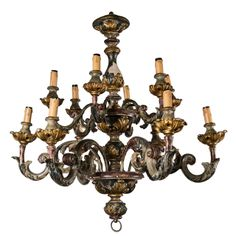 Painted And Gilded Wood  12 Light Chandelier. Rococo. Italian. hand carved wood with hand painting and gilding. Good condition, some chips. c1910