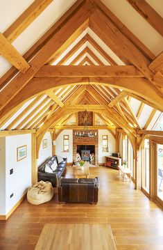 """""""We wanted exposed structural oak beams in the master bedroom and the main living space"""" explains Chris, Oakwrights Homeowner Oak Framed Buildings, Wooden Buildings, Living Room Designs, Living Spaces, Log Burner Fireplace, Oak Frame House, Rustic Home Design, Energy Efficient Homes, Storey Homes"""