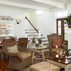 Bring the Outdoors In     Use naturally occurring colors and textures to give an earthy feeling to your living room. Potted plants and wicker furniture give this home a casual comfort.