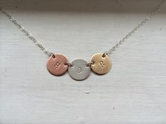 A personal favorite from my Etsy shop https://www.etsy.com/listing/214376612/three-disc-coin-necklace-with-initials