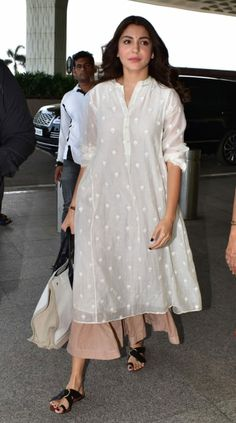 From Anushka Sharma's simple white look to Alia Bhatt's red brocade number, these celebrity kurtas are perfect for your Rakhi celebrations Ethnic Outfits, Indian Outfits, Fashion Outfits, Fashion Styles, Dress Fashion, Fall Outfits, Trajes Business Casual, Business Casual Outfits, Formal Casual Outfits