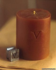 Use an antique letterpress type to monogram a candle with your own initials or personalize candles as a charming gift for friends.