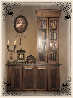 A picture of my book case that I edited with my clock, candlelabra and crystal ball box