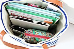 Great post on what she carries with her and how she keeps it all organized. Adding the mini-organizer to my shopping list.