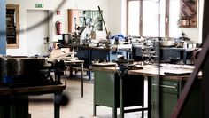 Industrial styled designer hanging lampshade handmade from steel barrels. The workshop.