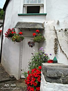 Come tumble down the cobbled streets of Clovelly with me today- a village in North Devon, England. This summer we went to look at a. North Devon, Arches, Welcome, England, Windows, In This Moment, Doors, Plants, Slab Doors