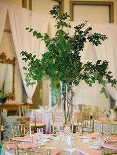 You'll go green with envy over these lush centerpiece ideas. Here are 15 way to use greenery in your wedding reception centerpieces.