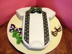 Onesie Bowtie Baby Shower Cake w a sheet cake under it?  A good alternatIve to ur traditional round tiered cake.
