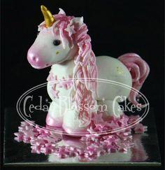 Unicorns for reeses bday cake