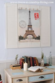 Create wall art with shutters and a poster.