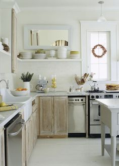 natural wood cabinets, open shelving, white floor