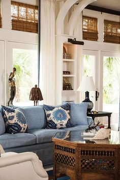 blue and white living room in Florida Clerestory windows with natural shades | white walls | white drapes