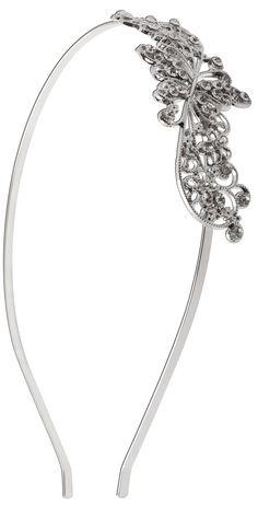 Material:  Haarreifen in Silberfarben mit Schmetterlingen und Blumen aus Metall, welche mit Strasssteinen besetzt sind.   Umfang:  dehnbar Breite:  max. 3 cm