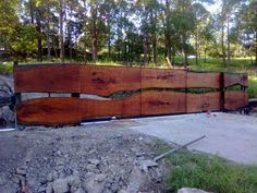 Google Image Result for http://www.gates-n-fences.com.au/images/gallery/full_Dogg-Design_slab-timber-sliding-gate.jpg