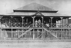 House in Emerald, Queenland with a short-ridged roof and a generous wraparound veranda, probably built between 1880s and 1890s. This home features acroteria ...