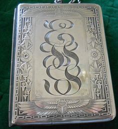 A sterling silver card case in the Egyptian Revival motif dated 1908