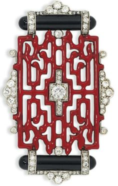AN ART DECO ENAMEL AND DIAMOND BROOCH, BY CARTIER. Of Oriental design, composed of a red enamel openwork panel, with old brilliant-cut diamond centre, mounted between polished onyx baton accents within a further diamond frame, circa 1925, 5.4cm wide, signed Cartier HSA, and numbered. #Cartier #ArtDeco #brooch