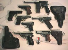 Mauser Schnellfeuer-selbstladepistole M30 - Walther PPK - CZ vz/27 - Walther PP - Luger (Parabellum) P08 with holster - J.P. Sauer M1913 - Walther P38 with holster - Mauser M1914 with holster.