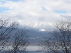 VISIT GREECE  Mt. #Mitsikeli extending behind #Ioannina city, #Epirus Region #Greece Visit Greece, Traveling, Clouds, In This Moment, City, Outdoor, Image, Viajes, Outdoors