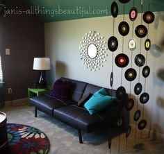 love the records on chains as a room divider - so cute for a game room!