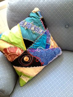 This crazy quilted pillow is hand made. It makes a statement and is one of a kind.