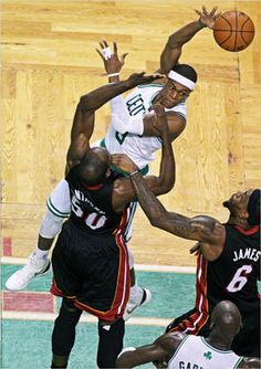 Rajon Rondo sailed as he dished an assist to teammate Kevin Garnett, who scored. Miami's Joel Anthony and LeBron James defended.