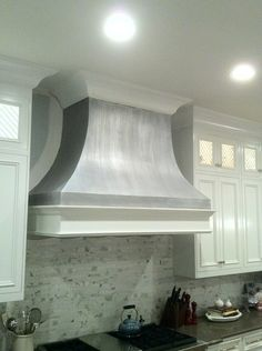 Nashville's Bella Tucker Decorative Finishes painted a drywall oven hood with a Modern Masters Metallic Pewter finish.