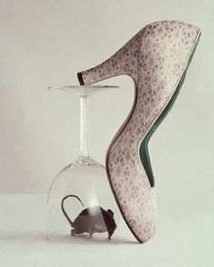 An elegant shoe, a glass, and a mouse photographed by Richard Rutledge for Mademoiselle, 1953.