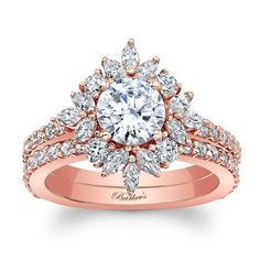 Stunning, in vogue, this rose gold diamond engagement ring features a prong set round center diamond artfully encircled with marquise and diamond melee, while shared prong set diamonds grace the shoulders for a timeless look of elegance. Dream Engagement Rings, Engagement Ring Styles, Rose Gold Engagement Ring, Halo Engagement, Wedding Rings Rose Gold, Rose Gold Jewelry, Bridal Jewelry, Wedding Band, Jewelry Rings