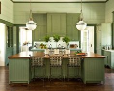 Southern Living - kitchens - Sherwin Williams - Oyster Bay - Benjamin Moore Pewter Green, green kitchen, green cabinets, green kitchen cabinets, painted cabinets, painted kitchen cabinets, green trim, crown molding, kitchen crown molding, paneled walls, green paneling, green wall panels, sage green paint, sage green paint colors, calacatta gold marble, calacatta gold marble counters, calacatta gold marble countertops, calacatta gold marble backsplash, green kitchen island, kitchen island ...