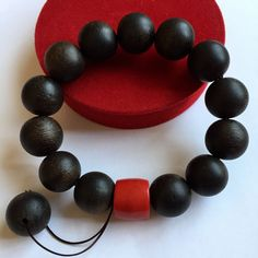 Vietnam Agarwood bracelets (bead 16mm - 36g) + Red Coral bead .