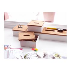 Store office clutter with cork. #design #storage #buget #IKEA KVISSLE Caja con tapa, juego de 4
