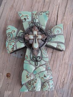 The curved shape....can use my bag of broken dishes. Turquoise glass cross from His House Mosaic Arts