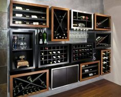 The wine racks/shelves could outline the back wall. But leave the middle for the mirror and liquor bottles. Hanging glasses are a must.