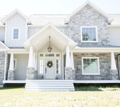 Love the white front door and Exterior grey stone. The exterior stone is gray w… Love the white front door and Exterior grey stone. Design Exterior, Grey Exterior, Modern Farmhouse Exterior, Wall Exterior, Farmhouse Style, Craftsman Exterior, Farmhouse Remodel, Rustic Farmhouse, Exterior Siding