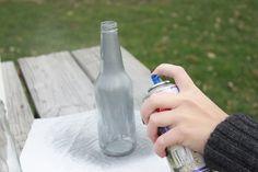 She sprays bottles with paint, then vinegar
