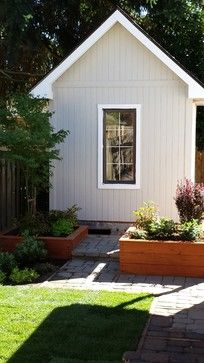 Love the wooden planters. They are small and look like part of the landscape.