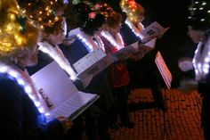 Carolers.  Use the lights in hair as a costume piece.
