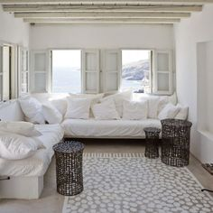 Less is more tiny room with plenty seating in white and naturals.