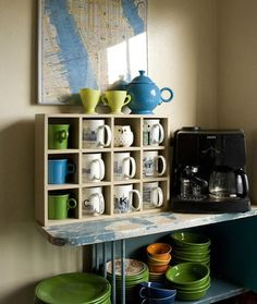 coffee station- coffee mugs in their own little cubbies, counter space for making hot drinks, framed artwork above.