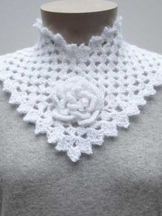 Flower Square Collar – – A crochet pattern from Nancy Brown-Designer. This beautiful accessory requires some advanced crochet experience. Start with a flower granny square for the center front and add the sides. Fasten with a crocheted button and Crochet Collar Pattern, Crochet Flower Patterns, Crochet Poncho, Bead Crochet, Crochet Flowers, Crochet Lace, Crochet Hood, Chunky Crochet, Crochet Capas