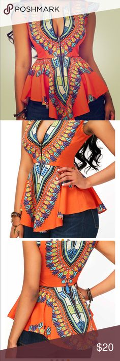 NWOT Dashiki print top Beautiful Dashiki inspired top with zipper front. Pairs perfect with jeans or a pencil skirt and heels. Sized as s large but fits more like a medium. Tops Blouses