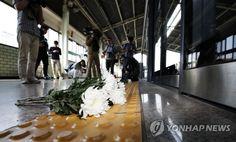 구의역에 놓인 국화꽃