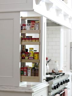 Pullouts to the side of the cooktop provide storage for spices and cooking oils.