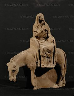 Woman on a mule. Terracotta figurine (end 1st BCE) from Myrina, Isle of Lemnos, Greece. Height 16 cm CA 2217 Louvre, Departement des Antiquites Grecques/Romaines, Paris, France