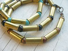 Casings collected by women on open fields, made into jewelry