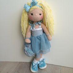 Amigurumi doll with little purse